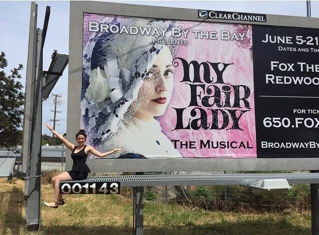 Image on a billboard with my model sitting next to it. Photo Credit for picture of billboard and model: Austin Scott
