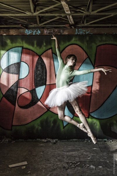 Final shot of the ballerina as she jumped in the beam of light.